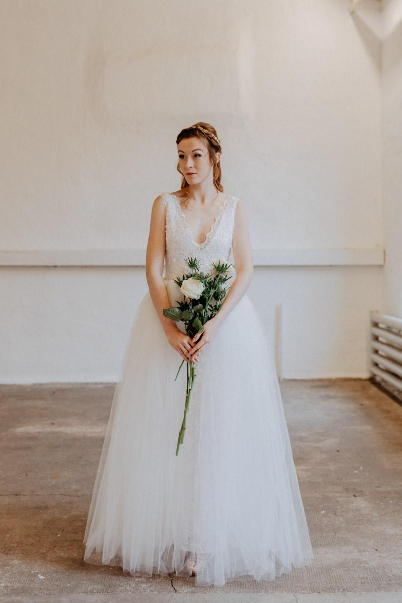 Braut in einem Brautkleid von Herzbraut Köln